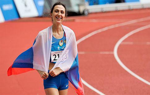Ласицкене победила в Китае и пробежала с флагом России. ВИДЕО